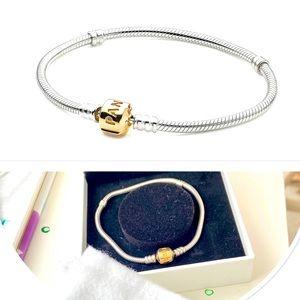 Pandora 14kt Gold and Silver bracelet (size 7.5)